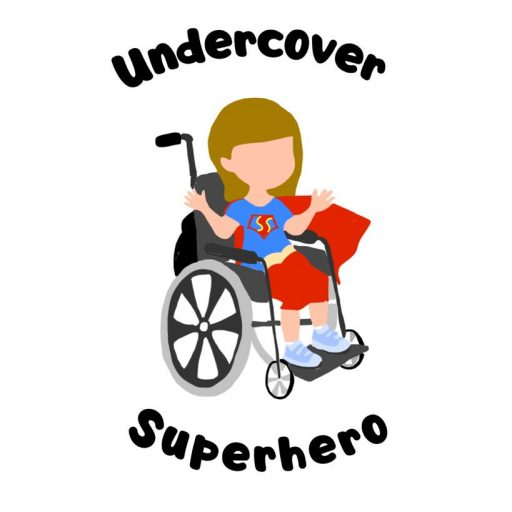 Ami's logo. A cartoon version of Ami sitting in a wheelchair, wearing a blue t-shirt, red trousers and a red cape. The word Undercover is placed at the top of the logo, formed in a semi-circle. The word Superhero is at the bottom, formed in a semi-circle similar to a smile.