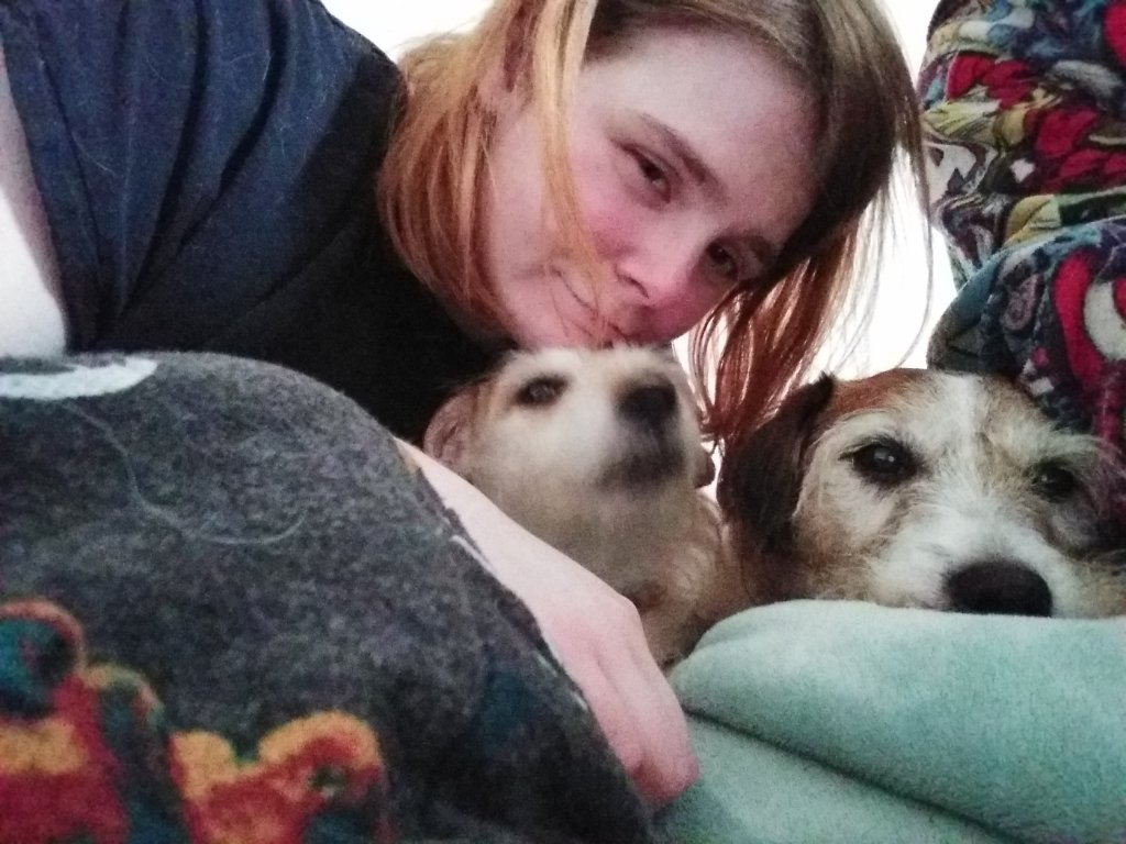 Ami has taken a selfie with Molly and Max, on her bed.