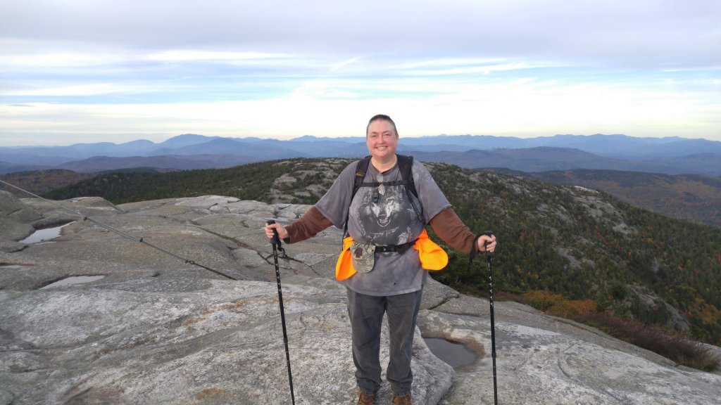 Carmel is standing on the summit of Cardigan Mountain, this was after Carmel's third brain surgery.