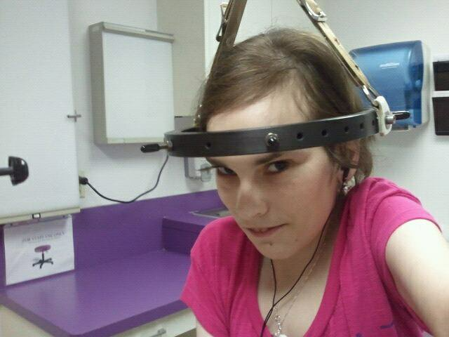 Jamie is wearing a Halo device whilst at Halo Traction, before her surgery.