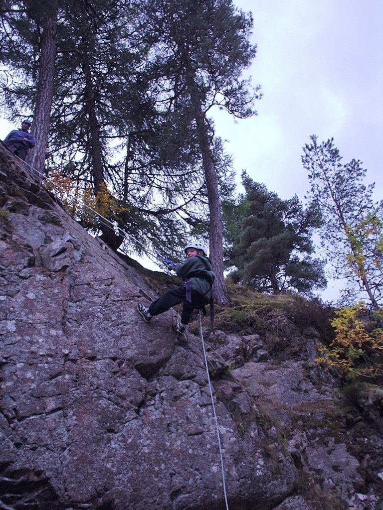 David is abseiling down a cliff.